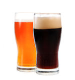 Amber ale and stout. Isolated on white background Stock Photos