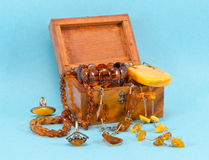 Amber apparel jewelry retro wooden box on blue Stock Photos