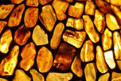 Amber background. Amber; background; baltic; decoration; glass, gold; jewellery, lamp; ornament, poland; sea; stained; stone Royalty Free Stock Image