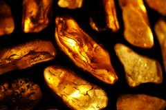 Amber background. Amber; background; baltic; decoration; glass, gold; jewellery, lamp; ornament, poland; sea; stained; stone Stock Image