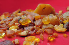 Amber background. Natural Amber background on a red table stock photography