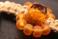 Amber bead Stock Photography