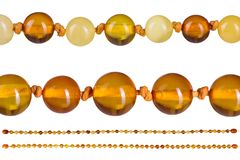 Amber beads accessory isolated on white Royalty Free Stock Images