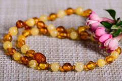 Amber beads accessory on tablecloth Royalty Free Stock Photo