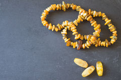 Amber. Beads from amber. Amber necklace on stone background stock images