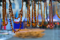 Amber beads on the Christmas Fair at New Year Stock Photography