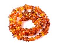 Amber beads isolated on white background Stock Images