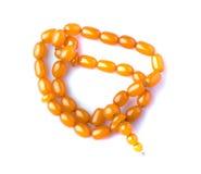 Amber beads isolated on white background Stock Photo