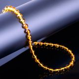 Amber beads accessory on black background Stock Photos