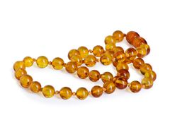 Amber beads accessory isolated on white Royalty Free Stock Photo