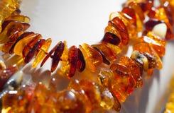 Amber beads on white background Stock Photos