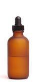 Amber Bottle. Single, frosted amber dropper bottle Stock Photo