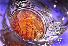 Amber bracelet. An amber bracelet in water from Poland close up Stock Photos