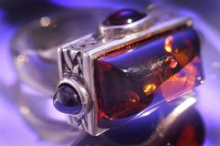 Amber bracelet. An amber bracelet in water from Poland close up Royalty Free Stock Photos