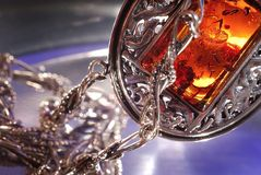 Amber bracelet. An amber bracelet in water from Poland close up Royalty Free Stock Photo