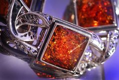 Amber bracelet. An amber bracelet in water from Poland close up Stock Photography