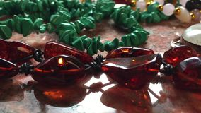 Amber bracelet and gemstones accessories stock video footage