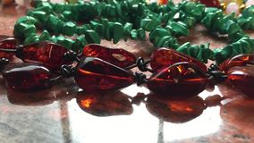 Amber bracelet and gemstones accessories stock footage