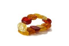 Amber bracelet isolated on white. Beautiful amber  bracelet  isolated on white Stock Photo