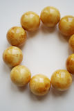 Amber bracelet with round beads close up on white background. Stock Photography