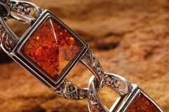 Amber bracelet on stone. An amber bracelet from Poland,  Close up Stock Image
