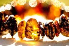 Amber bracelet in sun Stock Photography
