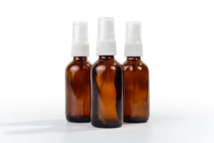 Amber Brown Glass Spray Bottles. Stock Photo