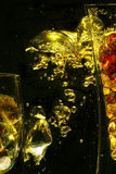 Amber Bubbles. Two underwater vases with bubbles rising up in between them lit up in amber color royalty free stock photo