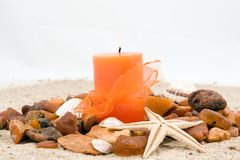 Amber candle and starfish Stock Photography