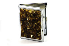 Amber  cigarette case. Amber   ccigarette case on the white background Royalty Free Stock Photo