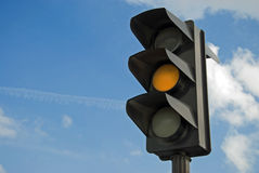 Amber color on the traffic light Stock Photos