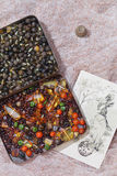 Amber colored stones and old post card. On fabric background Stock Photography