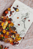 Amber colored stones and old post card Stock Photography