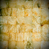 Amber-coloured marble mosaic. For background or texture royalty free stock photography
