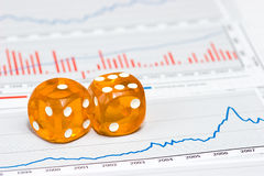 Amber dice on figures Stock Photography