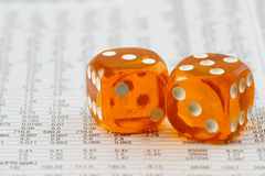 Amber dice on paper Royalty Free Stock Photos