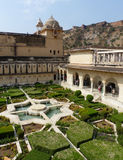 Amber Fort: the charbagh gardens. Traditional Persian style of garden design adopted by the Mughals. To the right is the Sukh Mandir Stock Images