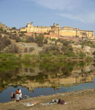 Amber Fort, India. Seen here with locals doing their daily wash in the Lake below royalty free stock image