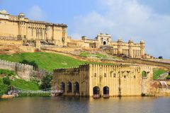 Amber Fort At Jaipur. Beautiful view of Amber fort overlooks the Maota Lake at Amer,Jaipur,Rajasthan. The Amer Fort is also popularly known as the Amer Palace stock photography