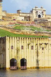Amber Fort At Jaipur. Beautiful view of Amber fort overlooks the Maota Lake at Amer,Jaipur,Rajasthan. The Amer Fort is also popularly known as the Amer Palace royalty free stock photography