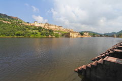 Amber Fort At Jaipur. Beautiful wide view of Amber fort overlooks the Maota Lake at Amer,Jaipur,Rajasthan. The Amer Fort is also popularly known as the Amer royalty free stock images
