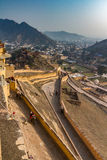 Amber fort and Jaipur. A view of the climb to the Amber fort with the city of Jaipur in the background Stock Photo