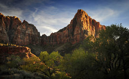 Amber and Gold Sunset Light on a Towering Rock in Zion National Park Royalty Free Stock Images