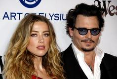 Amber Heard och Johnny Depp Fotografering för Bildbyråer