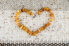 Amber heart Stock Images