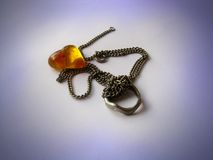 Amber heart with ring and necklace Royalty Free Stock Photo