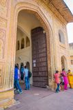 Amber, India - September 19, 2017: Unidentified people walking at the gate of the palace in Amber, India.  Stock Image