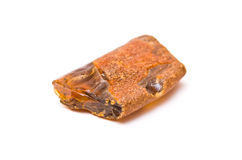 Amber isolated. Piece of amber isolated on white background royalty free stock image