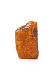 Amber isolated. Piece of amber isolated on white background Royalty Free Stock Photography