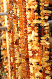 Amber jewelry. In bright sunlight Royalty Free Stock Photos